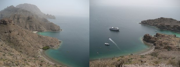 View from a ridge top on a Baja desert island with a small ship cruise and other boats anchored in the water.