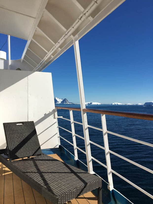 Lounge chair on a Premium Balcony suite cabin aboard a small ship in Antarctica.