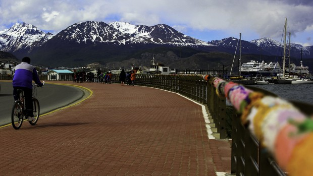 On tour in Ushuaia, Argentina along a boardwalk with the mountains in the background.