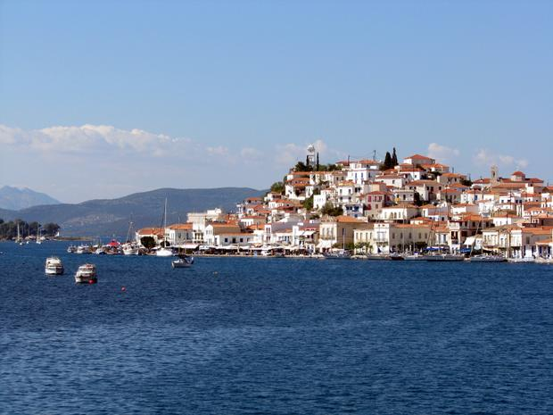 View from a small ship cruise of a town on the hillside in Greece.