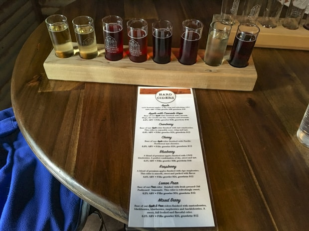 Flight of hard cider samples on a tour off a pacific northwest river cruise.