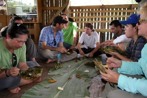 A group of people enjoying a meal in the Sani village.