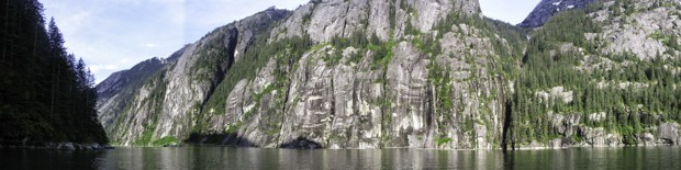 A scenic Alaskan fjord with granite sheer rock.