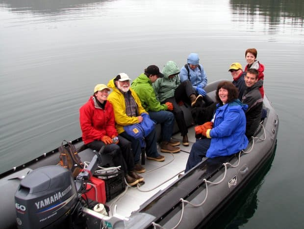 A group of people on a zodiac in Alaska.
