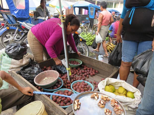 People buying vegetables at the market in Peru.
