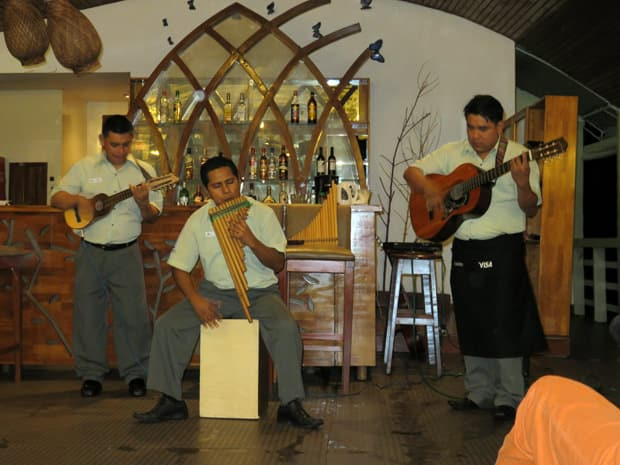 Three crew members of the Amatista playing music.