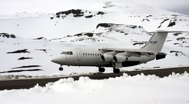An Antarctica air cruise airplane taking off from a snowy airstrip