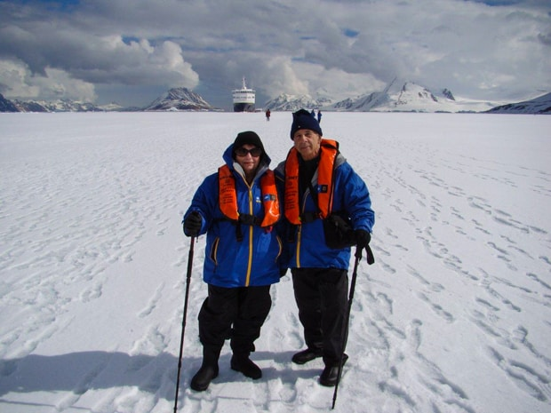 Small ship cruise expedition guests on a hiking excursion on the snow in Antarctica.