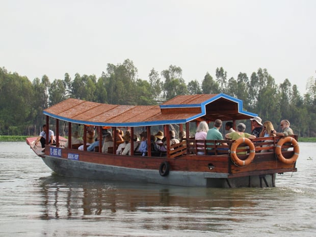 Guests relaxing on Mekong River cruise excursion.