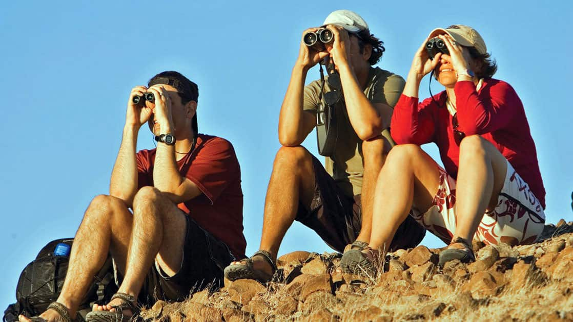 group of baja travelers with binoculars