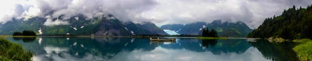Canoeing in front of a glacier from a wilderness lodge in Kenai Fjords Alaska.