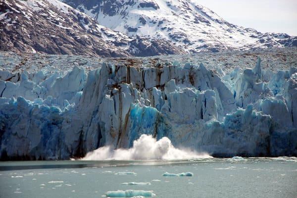 Dawes Glacier calving in Alaska as seen from a small ship cruise.