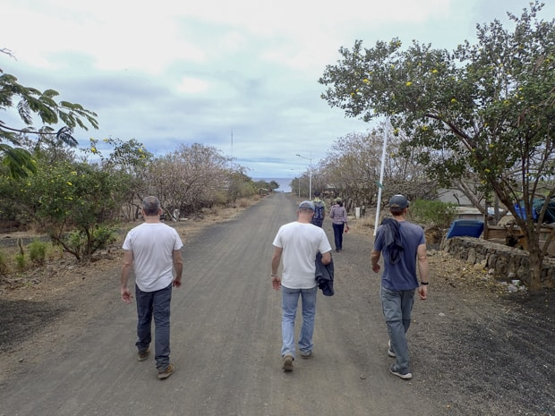 Group of people walking down a dirt road in the Galapagos.