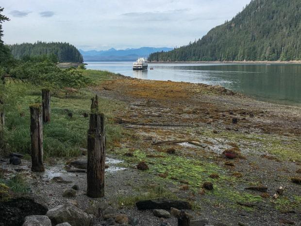 Small ship cruising through the Islands around Alaska.
