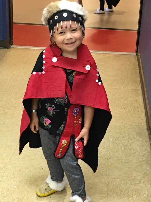 Tlingit child performer in traditional clothes in Alaska.
