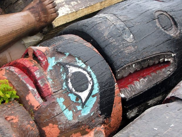 An up close picture of a totem pole in Alaska.