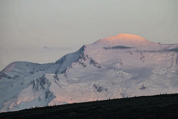 Sunset alpenglow on snowy peaks of Denali.