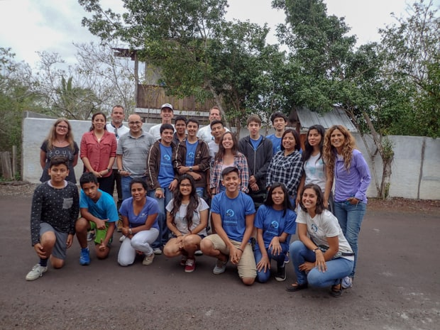 A group of local students and volunteers in the Galapagos islands.