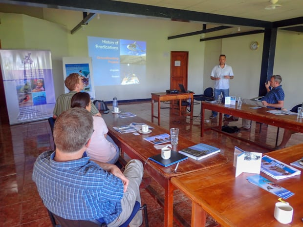 A group of people in a meeting room looking at a power point in the Galapagos.