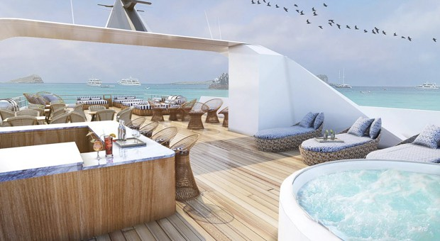 The sun deck on Theory Galapagos ship with lounge chairs, bar and jacuzzi