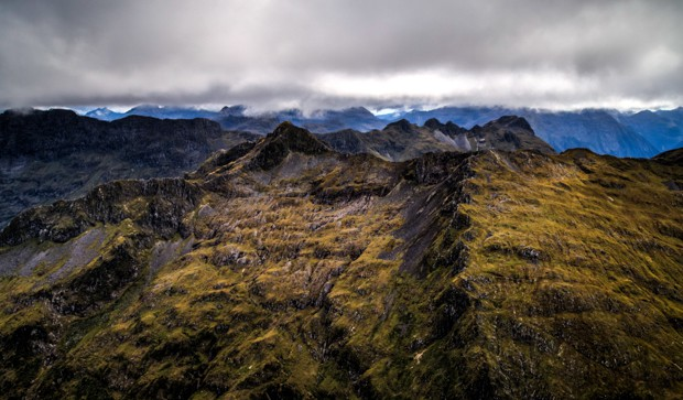 Scenery of mountains seen from a helicopter excursion off a small ship cruise in New Zealand.