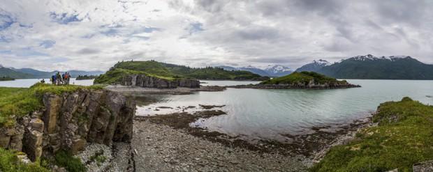 People on a coastal hike with the islands and shoreline of Katmai Alaska.
