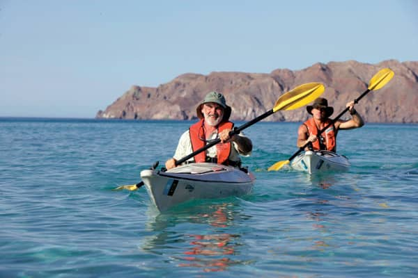 baby boomers kayaking in baja