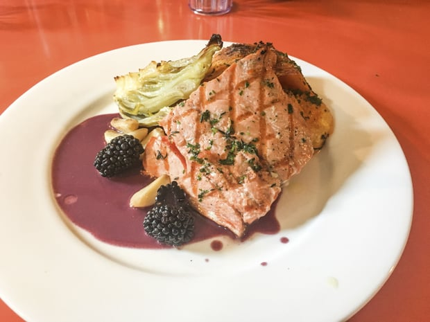 Fresh local salmon dinner served aboard Ursus small ship cruise in Alaska.