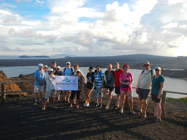 Group of Adventuresmith Explorations travelers on a view point in the Galapagos.