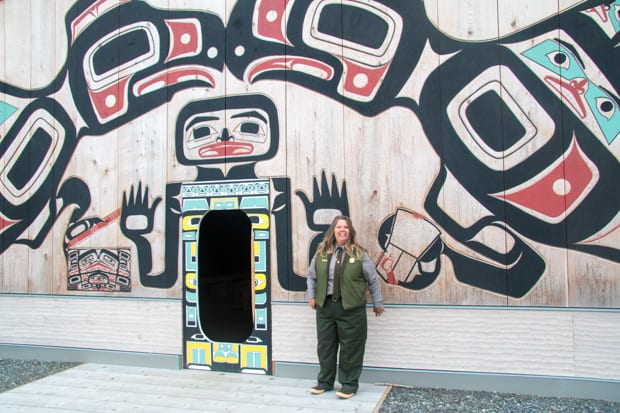 National Park employee standing in front of cultural interpretive center.