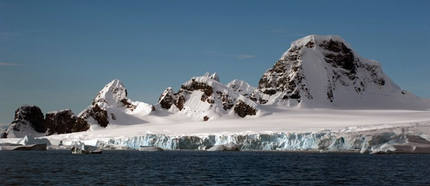 Landscape of ice shelf and mountain peaks seen from a small ship expedition to South Georgia and Antarctica.