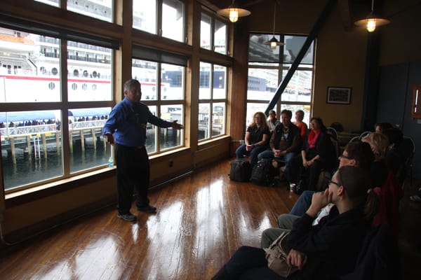 Native Tlingit tribe member welcoming tour group from small ship cruise in Ketchikan, Alaska.