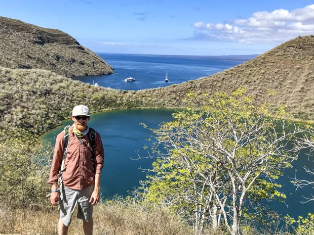 Galapagos traveler on a hike overlooking Sullivan Bay.