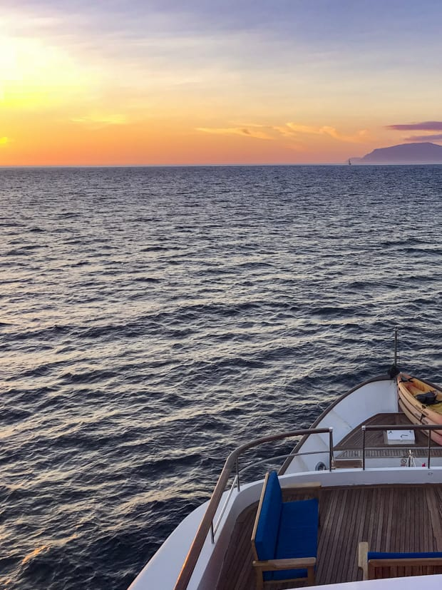 Sunset view from the top of the small ship cruise Passion in the Galapagos.