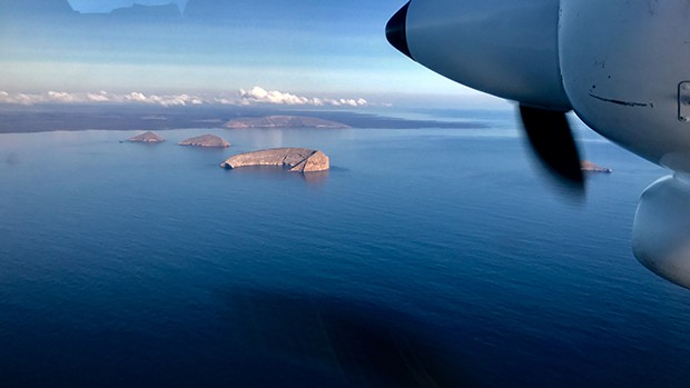 View from an airplane of a chain of islands in the Galapagos.