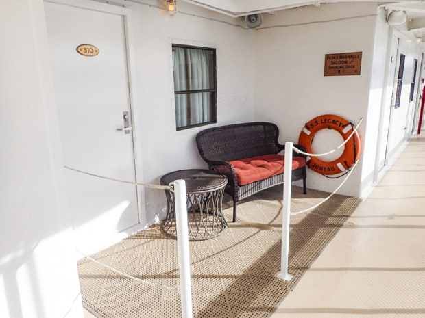 Lounge area on deck outside an Admiral cabin aboard S. S. Legacy.
