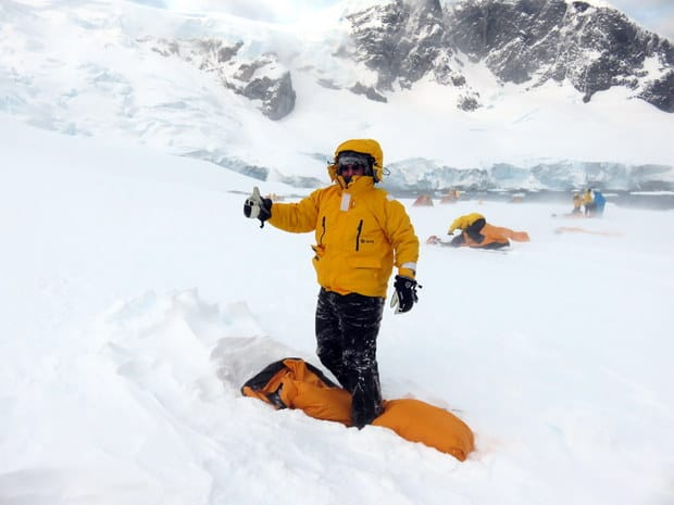 Passenger from small ship cruise in Antarctica camping on the snow.