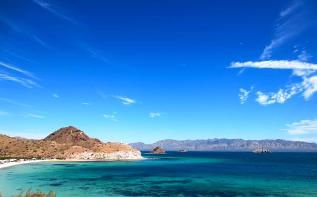 Sunny day with blue sky and bright blue and teal water in Baja California along the coast