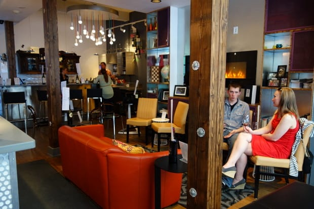 People sitting down at the wine bar and lounge at the Silverbow restaurant in Juneau Alaska.