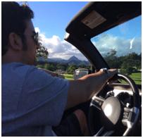 Traveler driving a convertable