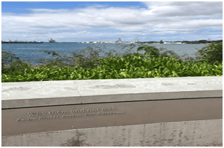Waterfront of Pearl Harbor with inscription (not legible)