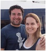 The honeymooning couple smiling