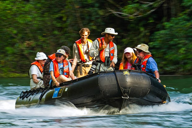people aboard a zodiac on a costa rican river
