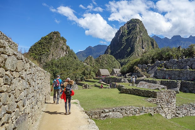 People hiking toward Huayna Picchu at Machu Picchu in Peru.