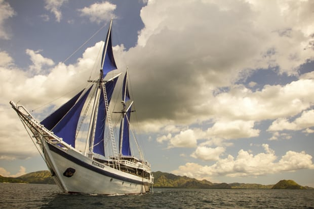 Small ship Indonesia cruise aboard traditional sailing vessel Ombak Putih.