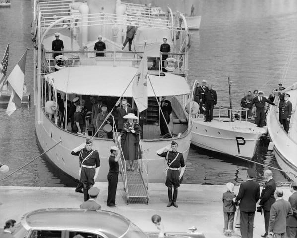 Royal couple disembarking motor yacht Grace in the 1950's.
