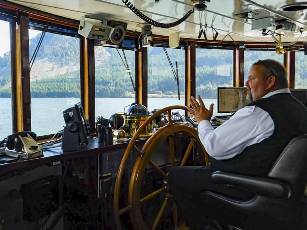 Captain Tim Voss on the bridge aboard small ship S.S. Legacy in Alaska.