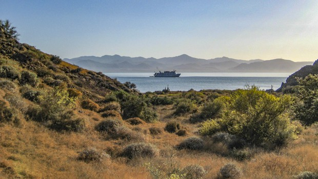 Small ship in calm bay in Baja California.