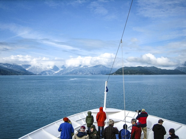 Passengers on bow of small ship cruising the Inside Passage of Alaska.