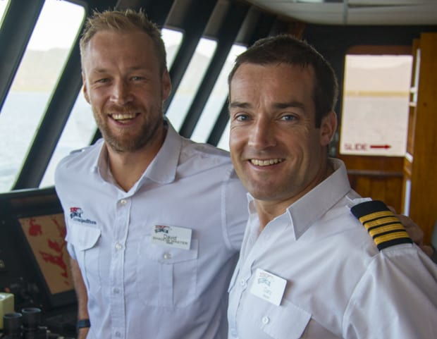 Captain Gary Walsh and crew on the bridge aboard Coral Expeditions II small ship cruising the Great Barrier Reef, Australia.